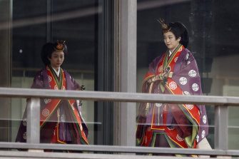 Japan's Princess Kako and Princess Mako arrive for a ceremony to proclaim Emperor Naruhito's enthronement to the world.