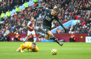 Leicester's Jamie Vardy beats Aston Villa keeper Tom Heaton at Villa Park on Sunday.