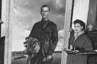 Anna Zinkeisen wth her portrait of Prince Philip in 1956.