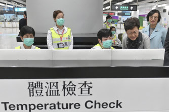 Chief Executive Carrie Lam, second from right, at the temperature check counter at West Kowloon Station in Hong Kong on January 3.