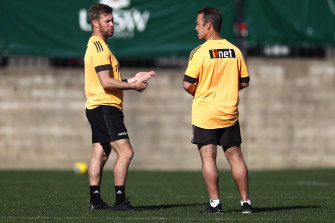 Former premiership Hawk Sam Mitchell with coach Alastair Clarkson.