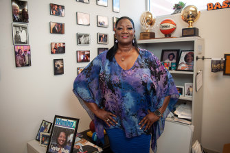Denise Taylor, known as Coach T, spends her days talking people into getting vaccinated.