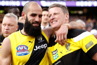 Bachar Houli (left) with coach Damien Hardwick after Richmond's 2017 grand final win.