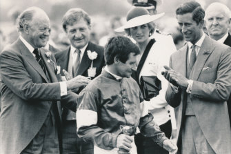 Charles and Dianna congratulate winning jockey Pat Hyland who rode What a Nuisance to win in 1985.