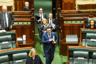Daniel Andrews arrives for question time with some of his remaining cabinet colleagues in tow.