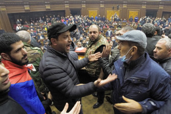 Unhappy with the peace deal, protesters break into parliament in Yerevan, Armenia.