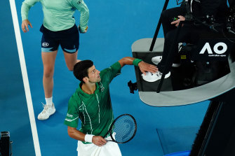 Novak Djokovic taps the chair umpire's foot during the Australian Open final.