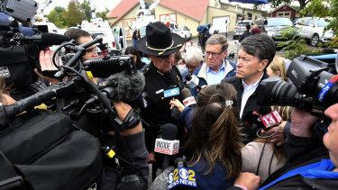 Schoharie County sheriff Ronald Stevens (left) and New York State senator James Seward (centre) speak to reporters at the scene of the crash.