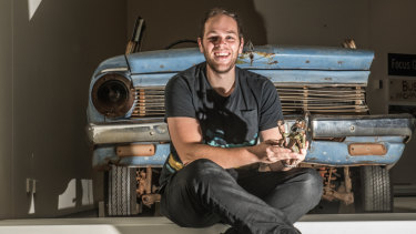 Curator Mick Bolognese  with the 1962 EJ Holden and a claymation character.