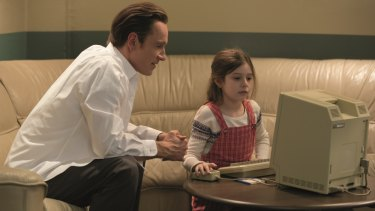 A scene from the film Steve Jobs showing Michael Fassbender as Steve Jobs and his daughter Kate as Lisa.