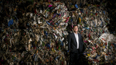 Harry Wang with a wall of plastics ready for recycling at his Advanced Circular Polymers plant in Somerton.