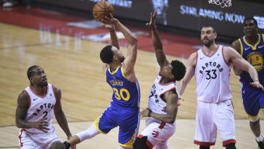 Hot shot: Warriors guard Stephen Curry shoots over Toront's Kyle Lowry.