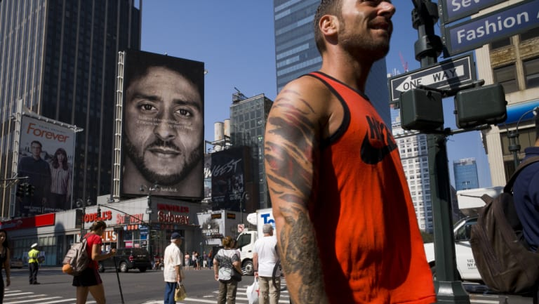 People walk by a Nike advertisement featuring Colin Kaepernick in New York.
