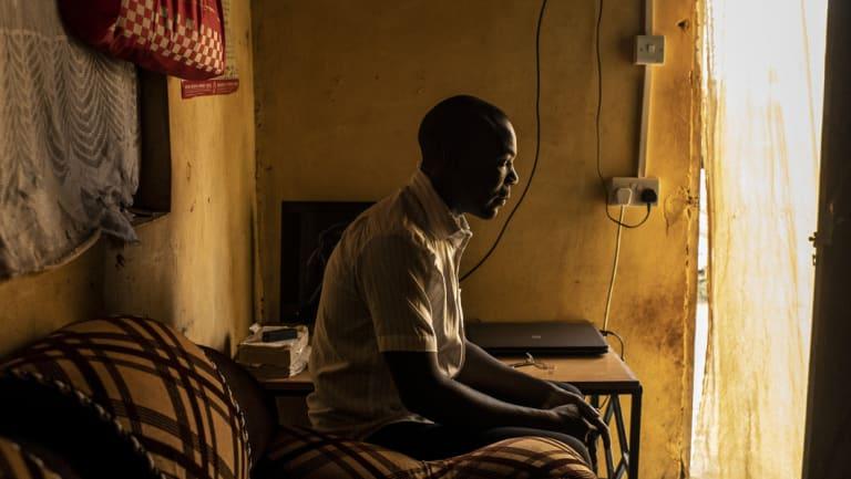 Richard Ochieng', 26, at his home in Nairobi, Kenya.