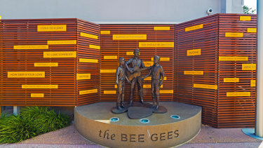 A sculpture depicting the Gibb brothers as boys on Bee Gees Way.