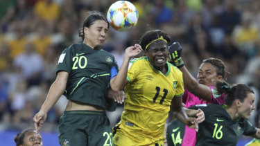 High-flying Matilda Kerr beats Jamaica's Khadija Shaw to the ball.