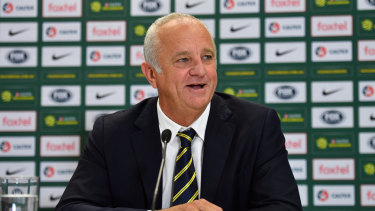 Dual roles: Australian coach Graham Arnold speaks to the media during a press conference in Sydney.