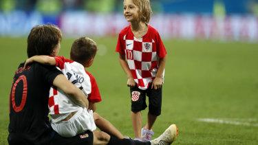 Croatia's Luka Modric, left, celebrates with children.