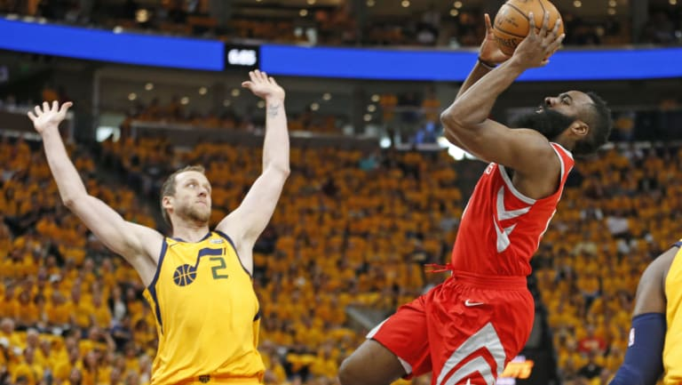 Harden shoots past Jazz forward Joe Ingles during the second-round playoff series.