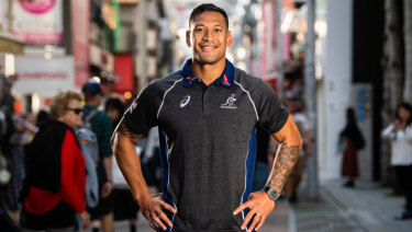 Star attraction: Folau poses for the cameras at a Wallabies fan event at the Asics store in Tokyo.