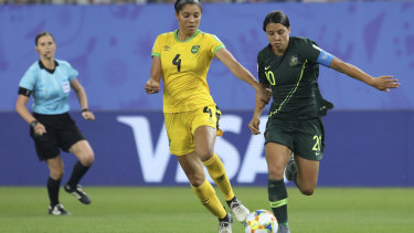Jamaica's Chantelle Swaby challenges for the ball with Australia's Sam Kerr .