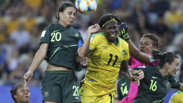 High-flying Matilda Kerr beats Jamaica's Khadija Shaw to the ball.