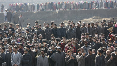 Kashmiri villagers gather to look at the wreckage of an Indian aircraft after it crashed in Budgam area on Wednesday.
