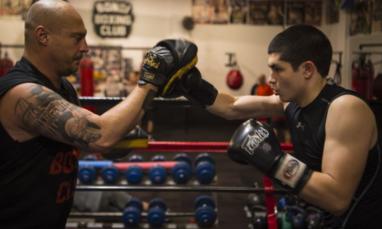 Kid gloves: Anton Markovic trains with Tony Del Vecchio in Waterloo.