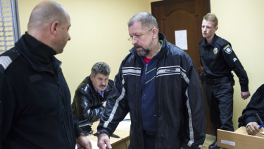 Oleg Smorodinov arrives for his trial in a courtroom in Rivne accused of the murder of Ivan Mamchur.
