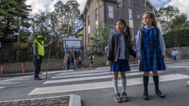 Year 2 students Ashleigh Ho and Victoria Spencer outside Chatswood Public School.