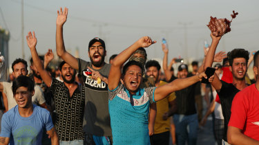 Iraqi security forces fired live bullets into the air and used tear gas against a few hundred protesters in central Baghdad.