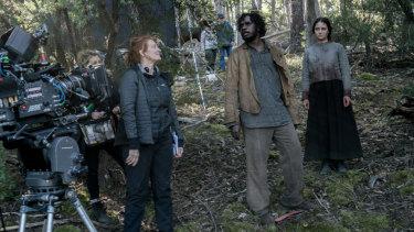 Writer-director Jennifer Kent, left, directs Baykali Ganambarr and Aisling Franciosi on the Tasmanian set of The Nightingale.