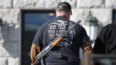 A man carries a weapon during a second amendment gun rally in Salt Lake City in February 2020.