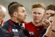 Playing to win: Simon Goodwin talks to his players.