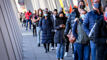 People queue for COVID-19 vaccinations at the Melbourne Convention and Exhibition Centre.