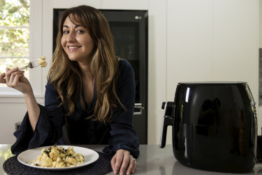 Air fryer obsessive Graziela Oborn makes air fried Cauliflower with Tzatziki, pine nuts and feta at her home in Balgowlah, Sydney on November 27, 2020. Photo: Dominic Lorrimer