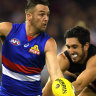 Matthew Suckling of the Bulldogs (left) and Jacob Weitering of the Blues contest during the Round 13 AFL match between the Carlton Blues and the Western Bulldogs at Marvel Stadium in Melbourne, Saturday, June 15,