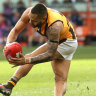 Jarman Impey hyperextends his knee after taking a mark against Geelong on Sunday.