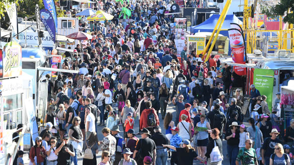 Biggest crowd at the Ekka since 2011 eats 220,000 dagwood dogs