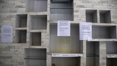 Notices hang near empty shelves after the removal of Chinese-made products in an electronic shop in Gauhati, India.