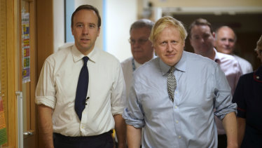 Health Secretary Matt Hancock and Prime Minister Boris Johnson during a tour of a hospital.