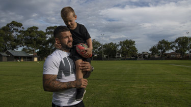 Family man: Adam Reynolds and four-year-old son Kobe enjoy a quiet moment in Mascot.