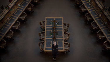 "Kate Torney in the empty reading room. The library will reopen ""as soon as we possibly can""."