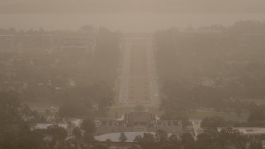 Wild winds dramatically reduced visibility in Canberra on Tuesday, blanketing Anzac Parade in dust.