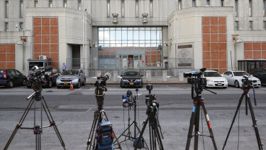 Media outlets set up cameras outside the main entrance of the Metropolitan Detention Centre, Brooklyn, where British socialite Ghislaine Maxwell is held.