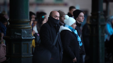 Commuters make their way to work in Melbourne on the coldest morning of the year so far.