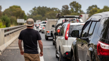 Vehicles queue to cross the NSW-Victorian border at Albury on Friday.
