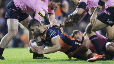 Alex Twal is tackled by the Panthers defence.