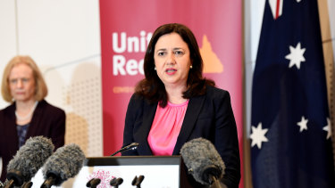 Queensland Premier Annastacia Palaszczuk speaks at a press conference as Dr Jeannette Young looks on.
