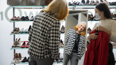 Marcia Scott tries out a jacket at Fitted for Work's fitting centre.